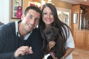 chocolate puppy with his new owners- Endless Mt. Labradors